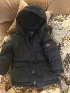 Winter coat for boy,size 6-7 . Color dark blue.