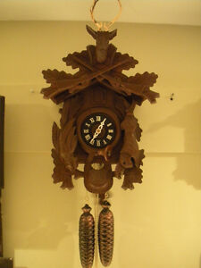 "Cuckoo clock ""8 day Hunter style""  In good running condition"