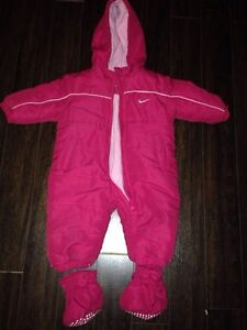 Lot of infant snow suits.  New born sizes up to size 2