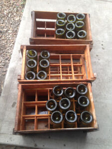 Wine bottles and wood storage boxes