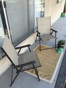 Two Foldable Patio Chairs with Rug