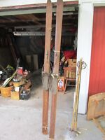 antique wooded skiis complete with poles