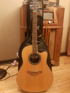 Guitar with soft case, metal stand and various accessories