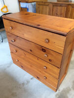 A pair of matching solid wood dresser