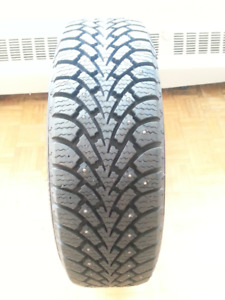 Four Goodyear Nordic studded winter tires. 195/70R14