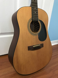 Acoustic Guitar with a set of brand new strings free!