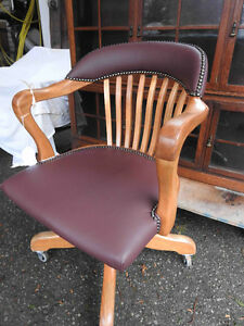 several antique office chairs restored with new leather seats