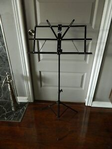 MUSIC SHEET HOLDER AND A DRUMMER STOOL