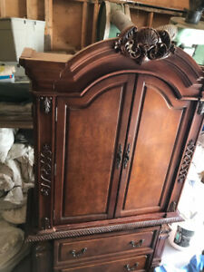 Reduced, reduced,Beautiful solid wood armoire.  Asking $1,200.00