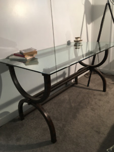 30-inch by 55-inch rectangular glass-top table with beveled edge
