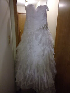 New wedding dress with tags still attached