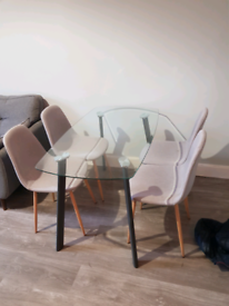 Glass table and 4 x grey dining chairs