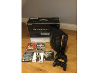 PlayStation 3 60gb with 2 controllers and 5 games