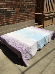 moving sale (A folderable couch—can be used as a bed)