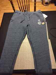 Men's roots track pants brand new.