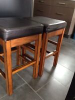 2 BLACK LEATHER AND SOLID WOOD BAR STOOLS