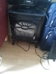 ELECTRIC FIRE PLACE WORKS GOOD  $ 10.00