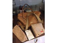 Storksak brown leather baby changing bag cost £198 new