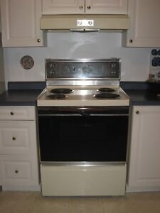 "30"" GE  stove with storage drawer and range hood beige color"