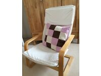 Rocking / baby feeding chair with cushion.