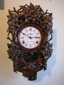 Beautiful hand carved wall clock. Mint!!!!!