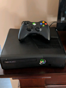 Xbox 360 Slim with 320GB hard drive + 4 games