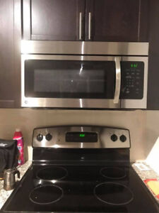 "MANUFACTURED IN 2016 GE 30"" stainless steel over range microwave"