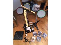 PlayStation 3 with Rock Band kit and 5 games