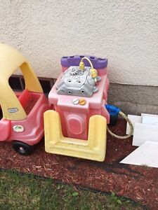Gas station and little tikes cars