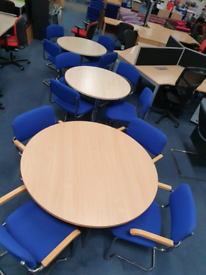 Used round tables with trumpet bases, huge Glasgow Showroom