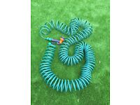 Long coiled hose pipe and spray gun
