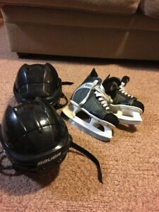 2 Bauer Hockey Helmets & a pair of CCM skates.