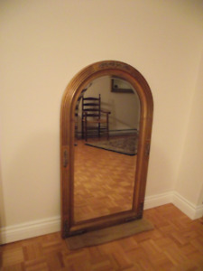 Gorgeous arched mirror with lots of framing detail