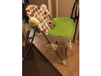 High chair, polka dot, reclining seat and adjustable height.