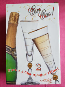 4 CHAMPAGNE FLUTE GLASSES / FLUTES A CHAMPAGNE - never used