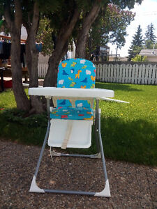Infants' feeding high chair for sale at $25.00