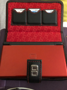 Red Nintendo DS with 4 games, charger, travel case