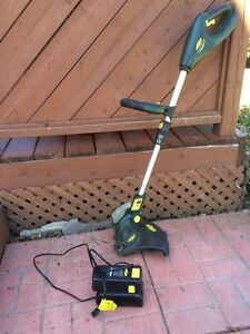Yardworks grass trimmer. Cordless. Rechargeable battery.