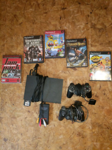 PS2 slim with 2 controllers and 5 games