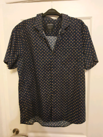 Two mens short sleeved shirts size XL