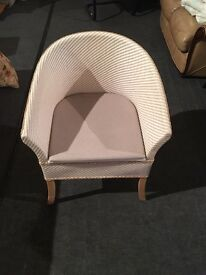 Commode Lloyd Loom style chair.