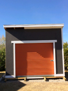 Used 8'wide x 7' high metal roll up doors