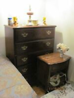 five drawer dresser, two single beds, and bedside table