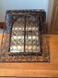 Wrought iron framed wall mirror