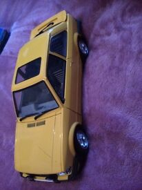 Yellow ford escort toy car