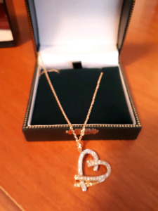 Beautiful Gold and 10 k white gold diamond heart necklace.