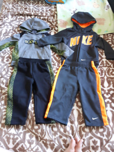 2 brand new 18 month track suits.