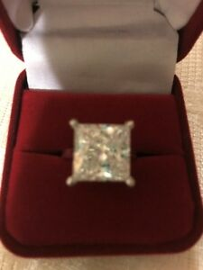 14 KT WHITE GOLD RING WITH CUBIC ZARKOON DIAMOND