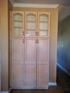 Bleached oak kitchen cabinets. Includes pantry with glass doors