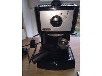 Delonghi black and silver coffee machine